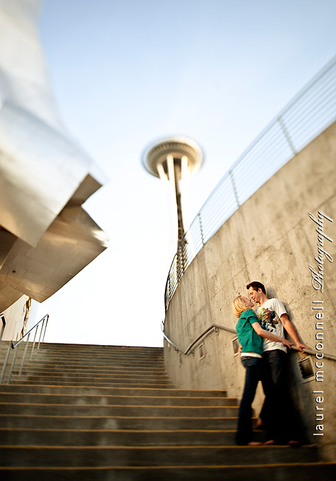 couple kissing under the space needle and emp