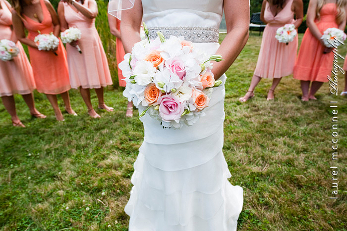 seattle wedding photographer Laurel McConnell photographs peach and pink roses bouquet and peach bridesmaid dresses