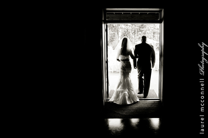 silhouette photograph of a bride walking down the aisle with her  father by laurel mcconnell photography in seattle