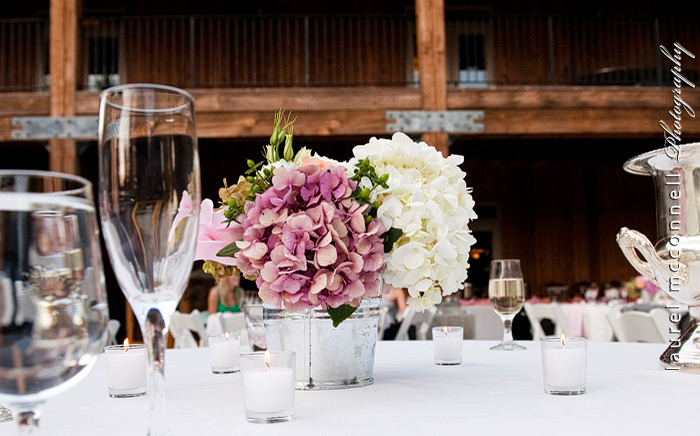 outdoor reception bridal vintage pink decor at a lodge by seattle  photographer laurel mcconnell