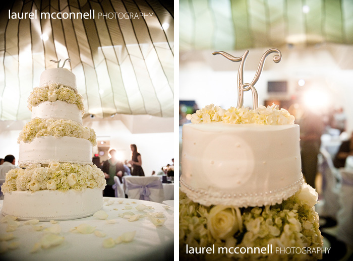 ivory wedding cake with monogram topper and hydrangeas