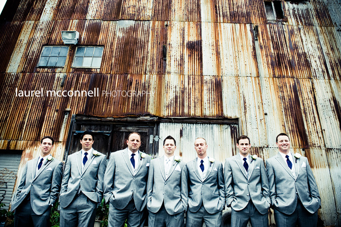 seattle wedding groomsmen and groom in grey suits by rusty warehouse