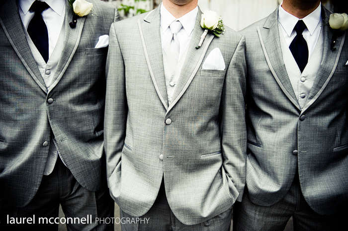 grey groomsmen and groom suits and ties with white boutonniere