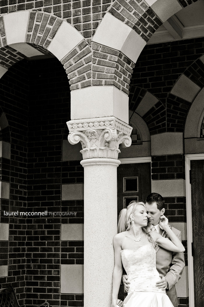 brick and columns with bride and groom
