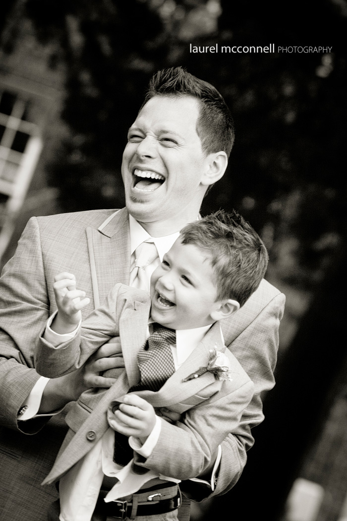 groom and ring bearer laughing at a wedding