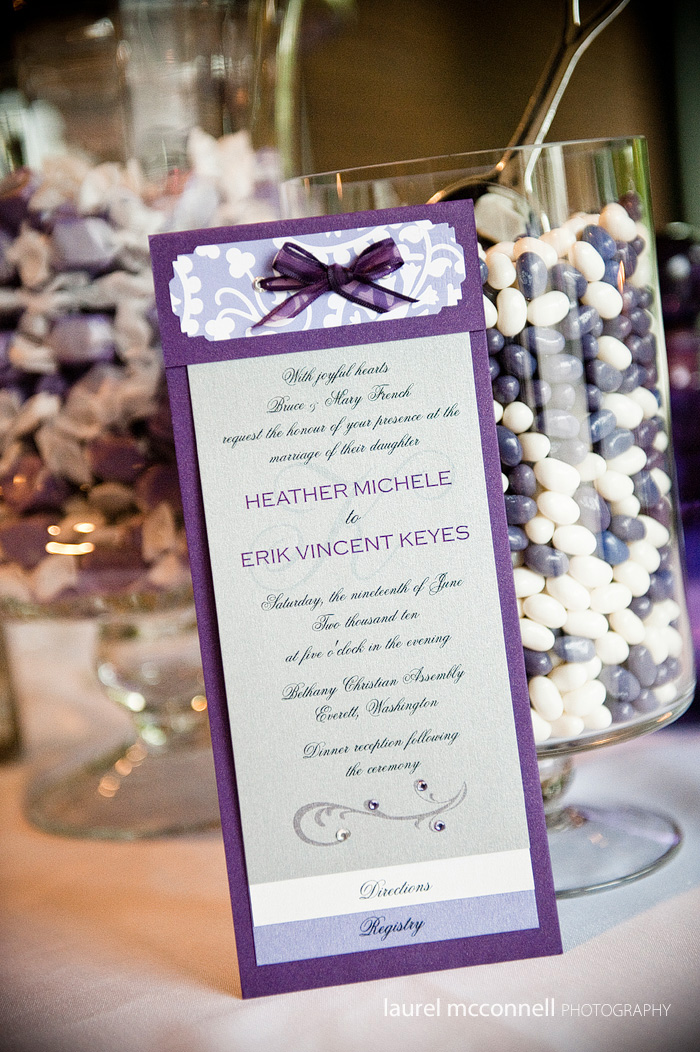 purple wedding invitation and candy bar
