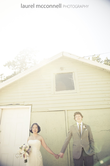 vintage inspired orcas island wedding at doe bay in front of a boat house