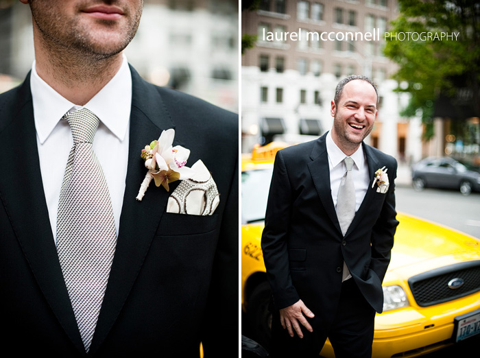 a modern groom in seattle waiting by his cab wearing a custom tie and pocket square