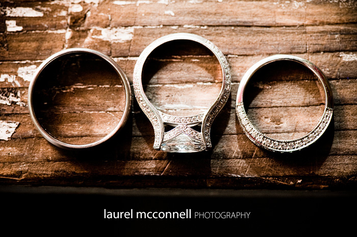 wedding rings with marquise diamond on rustic antique wood table
