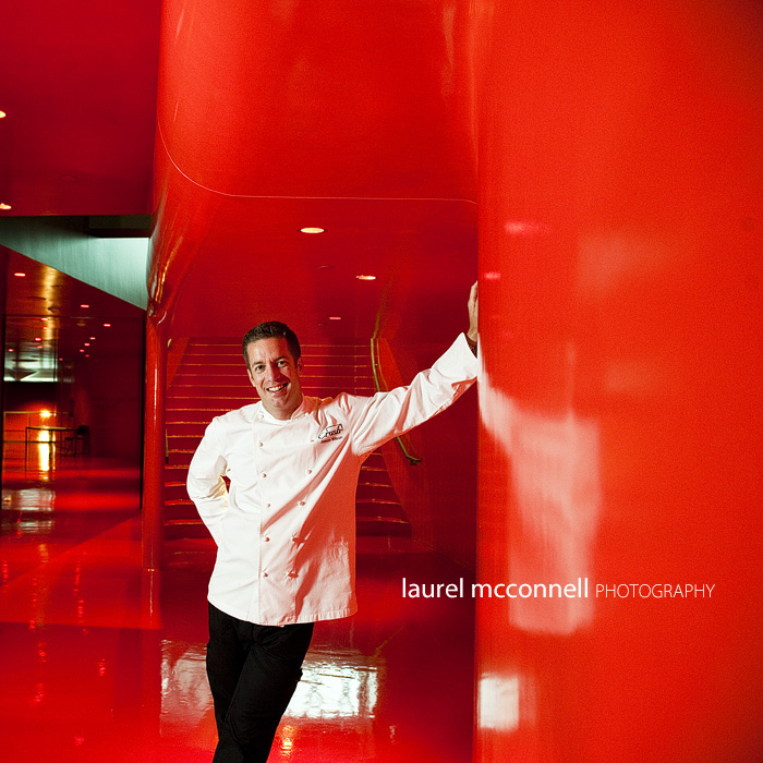 commercial portrait of chef Jason Wilson of Crush in a shiny red hallway at the Seattle Library