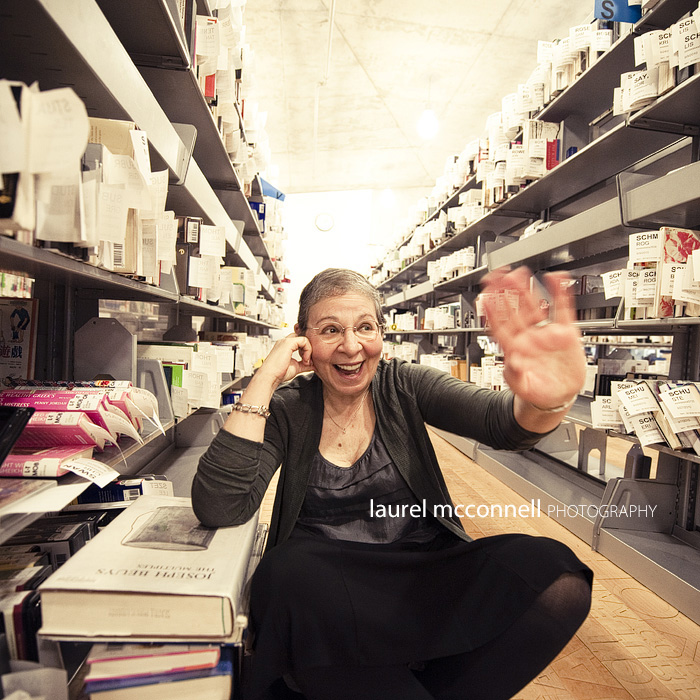 a portrait of famous librarian, author, and action-figure inspiration Nancy Pearl in the holds pickup area of the seattle public library