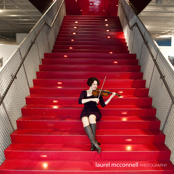 Seattle Symphony violinist Elisa Barston plays for us at the Seattle Libary during her portrait on the stairs