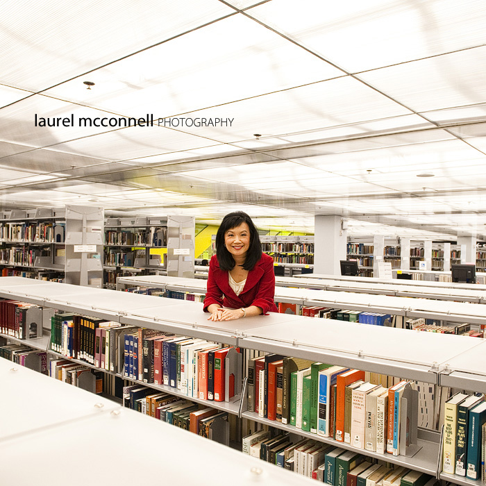Broadcast journalist Josephine Cheng poses in the Seattle Libary for an environmental portrait