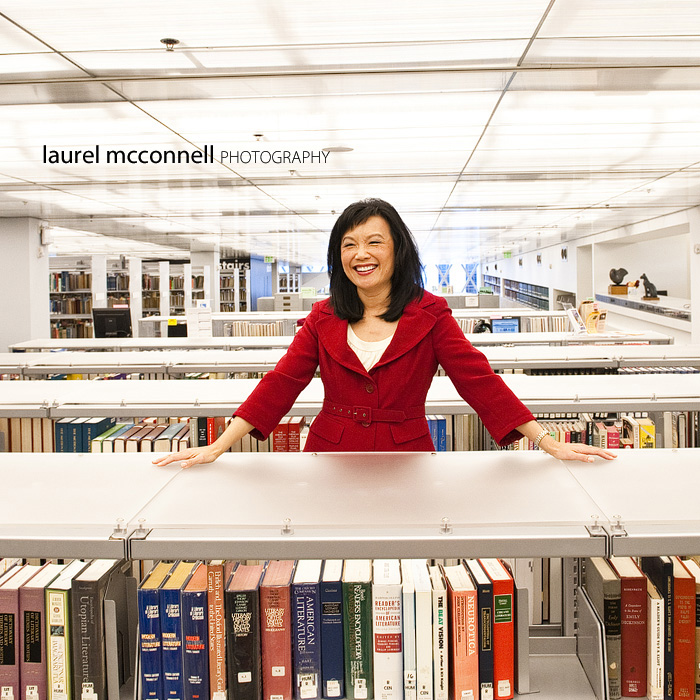 Happy Broadcast journalist Josephine Cheng poses naturally in the Seattle Libary for an environmental portrait