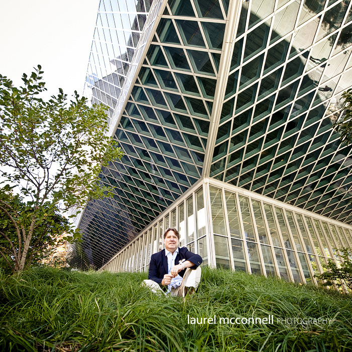 Businessman and CEO Terry Pillow of Tommy Bahama sits jovially for a picture in the grass outside the Seattle Public Libary