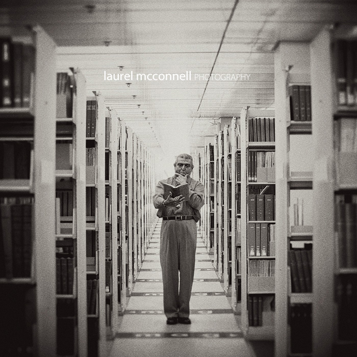 Seattle Municipal Court Judge Michael Hurtado poses thoughtfully for a portrait at the Seattle Library among old law books