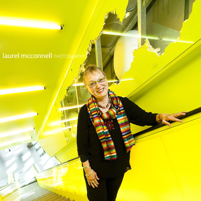 Sweet artist Joan Stuart Ross's portrait on the escalator at the Seattle Central LIbrary