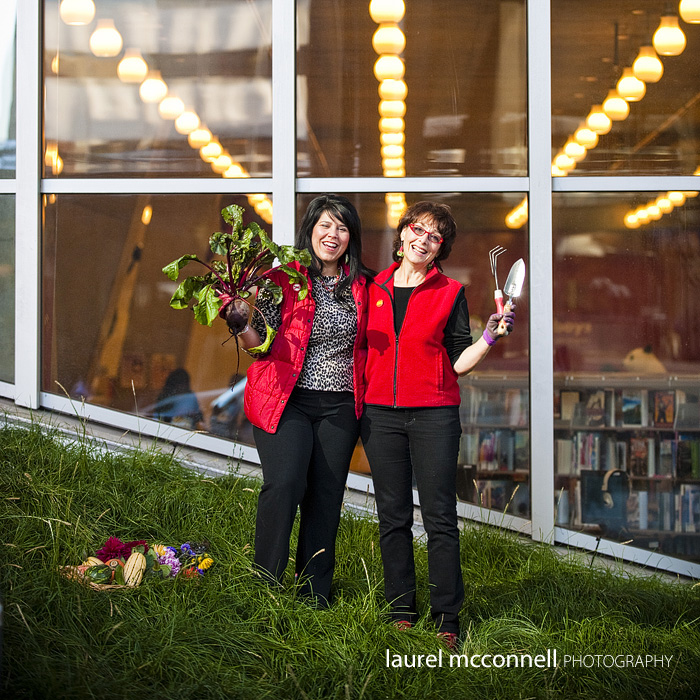 Local P Patch Foodbank founders Deb Rock and Jude Berman laugh outside of the Seattle Public Libary while posing for their modern take on American Gothic.