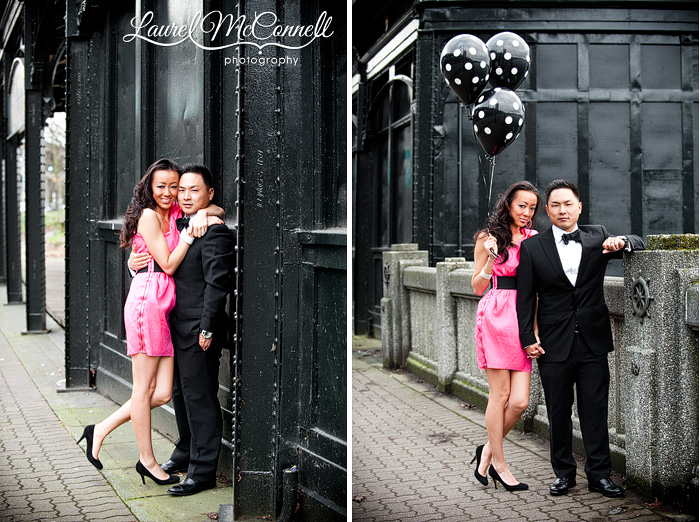 engagement portraits with polka dot balloons and bowtie and a tuxedo against a vintage steel wall on the Seattle waterfront