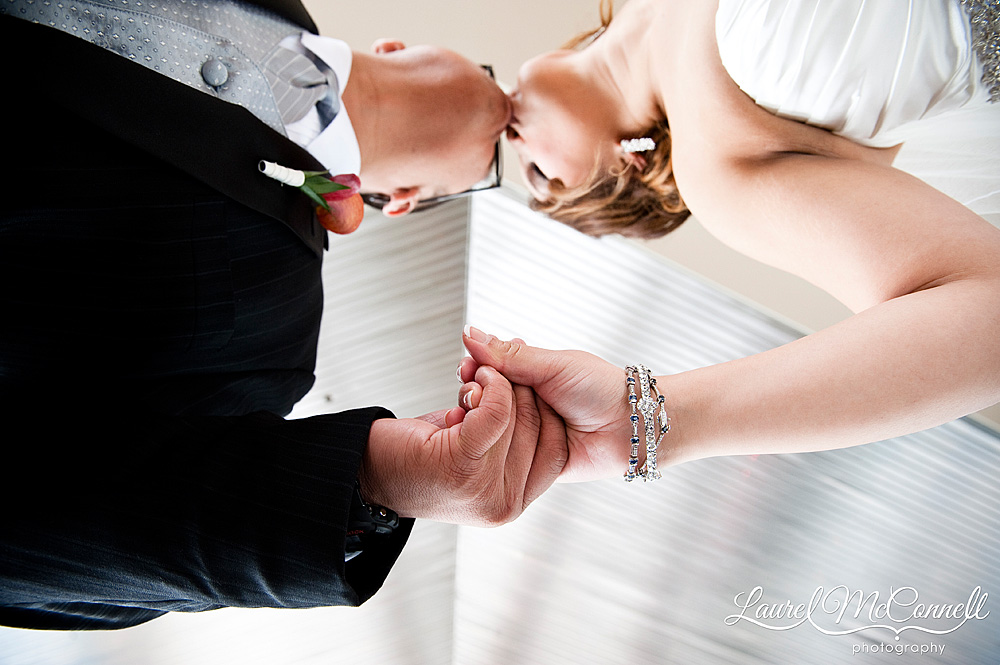 bride and groom by silver ceiling