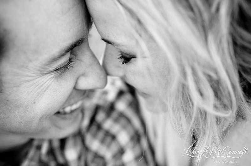 canoodling engaged couple in black and white for a reveiw on the nikon 35mm lens