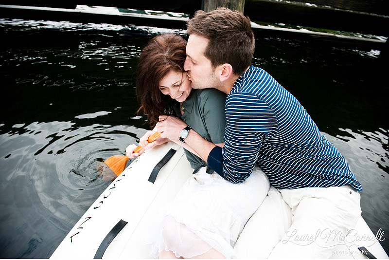 Seattle wedding photographer Laurel McConnell photographs this couple playing on a rowboat in a lake