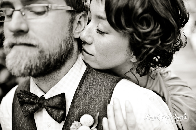 a steamy b&w scene in Seattle with this wedding couple snuggling. She's got pin curls. He's got a pinstripe suit.