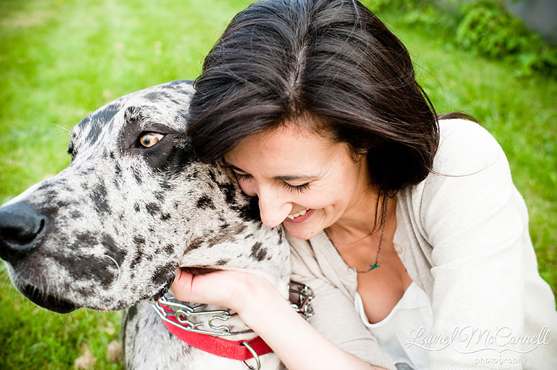 girl laughing with her spotted dog