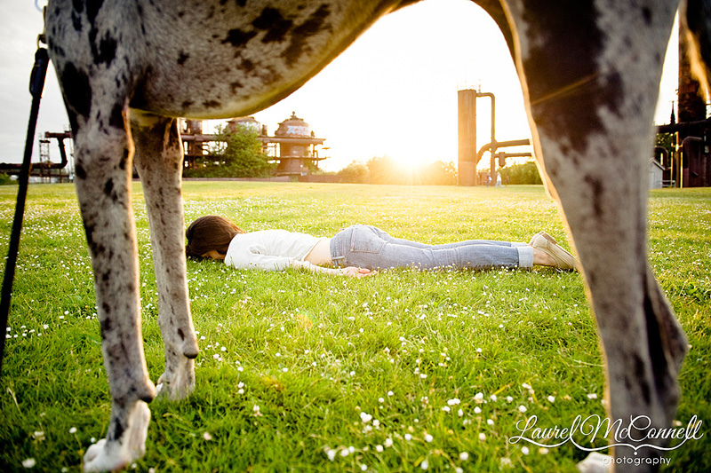 Facedown (like planking) of girl and dog at gasworks park