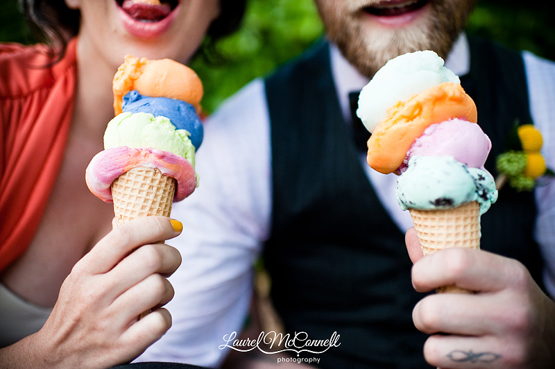 a couple eat colorful stacks of ice cream for their wedding portrait