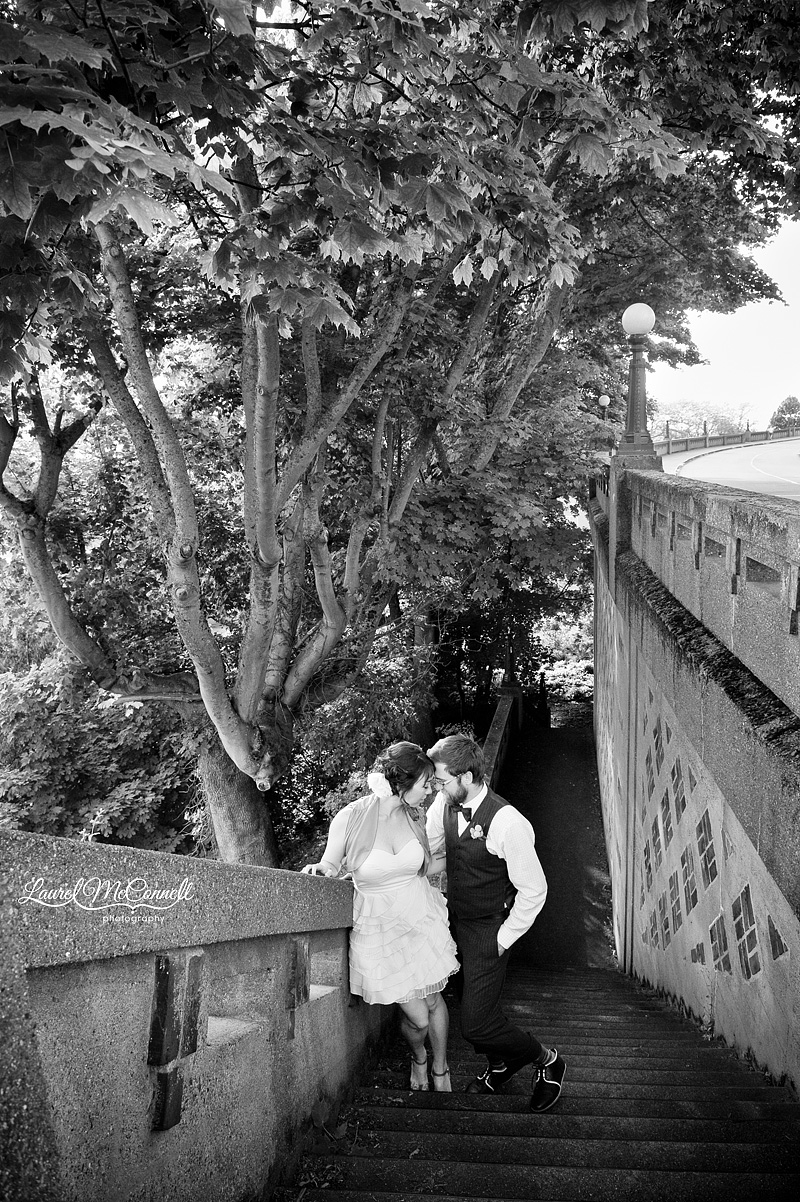 black and white landscape of trees and a couple during their anniversary portrait