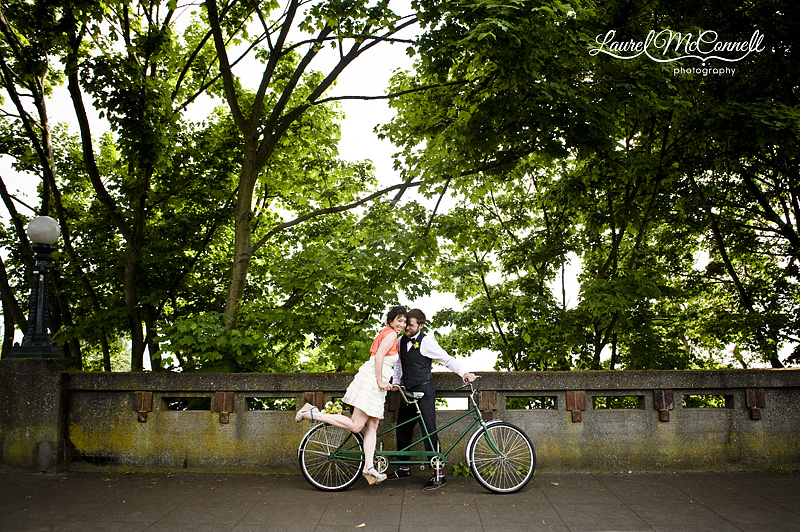 portraits of a short white dress and vintage pinstripe suit and tandem bike bicycle in seattle for wedding photography