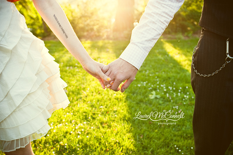 holding hands with sun flare and lens flare