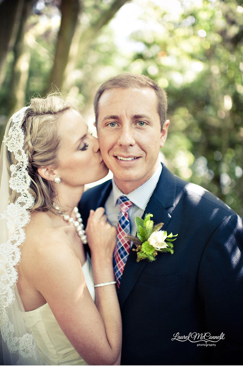 sweet wedding photography in seattle of bride in mantilla veil and groom in navy suit and red blue plaid tie
