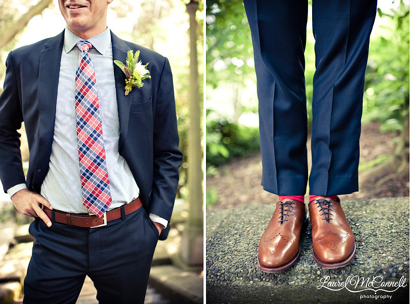 stylish groom in navy suit brown shoes and plaid tie