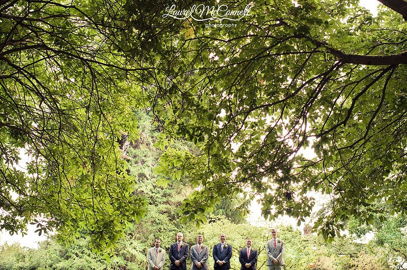 wedding photography of groomsmen wearing navy suits and grey suits