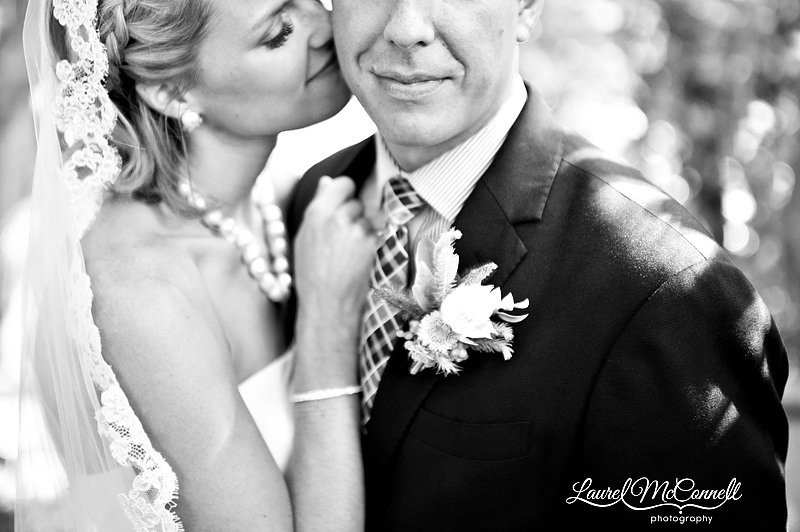 romantic snuggle picture of bride and groom in black and white at seattle's ballard locks
