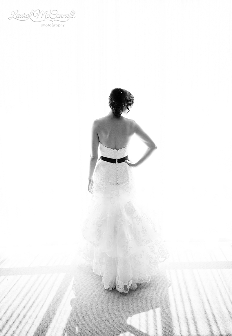 silhouette of bride in window in black and white for her seattle wedding