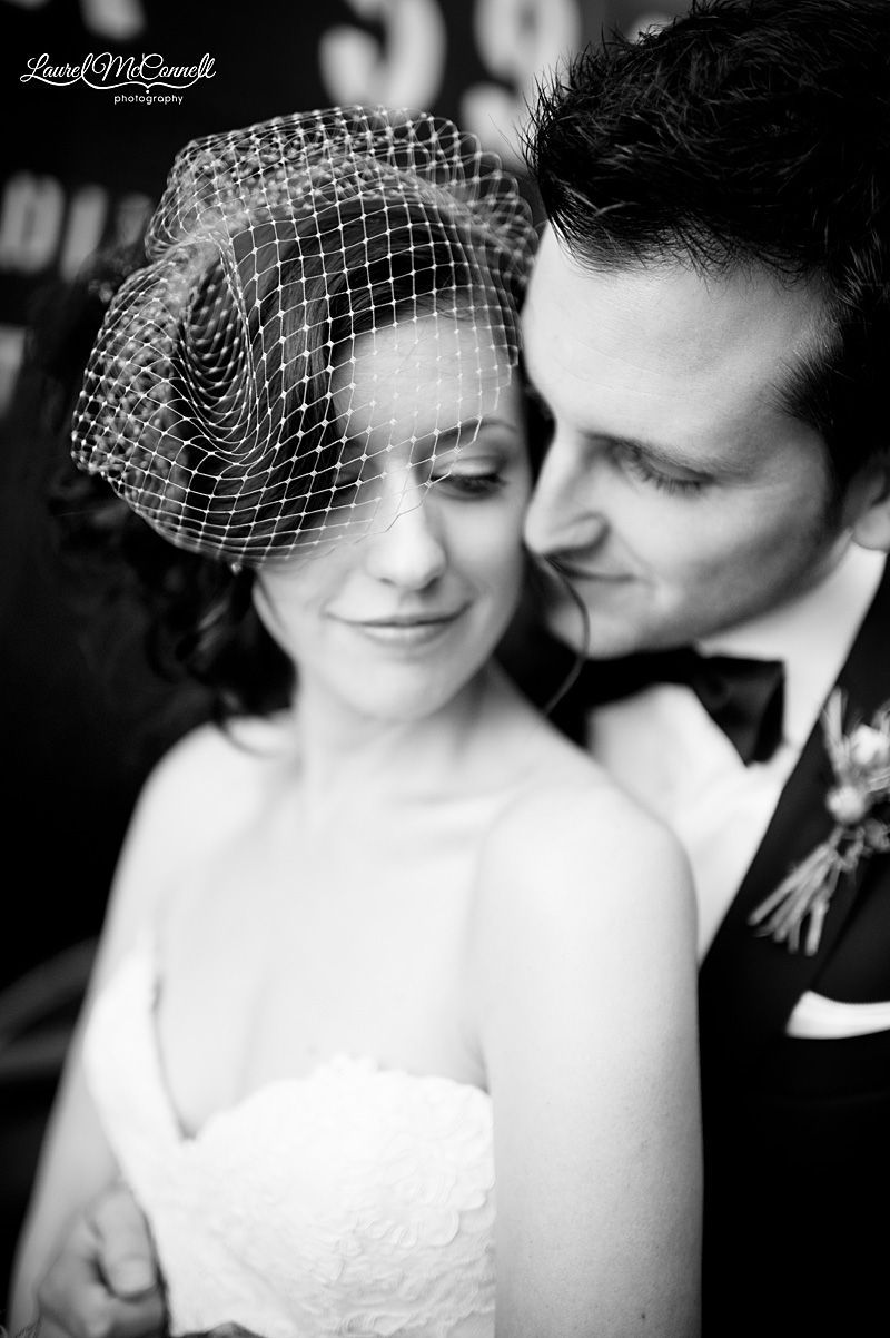 romantic wedding photography in seattle black and white birdcage veil couple snuggling