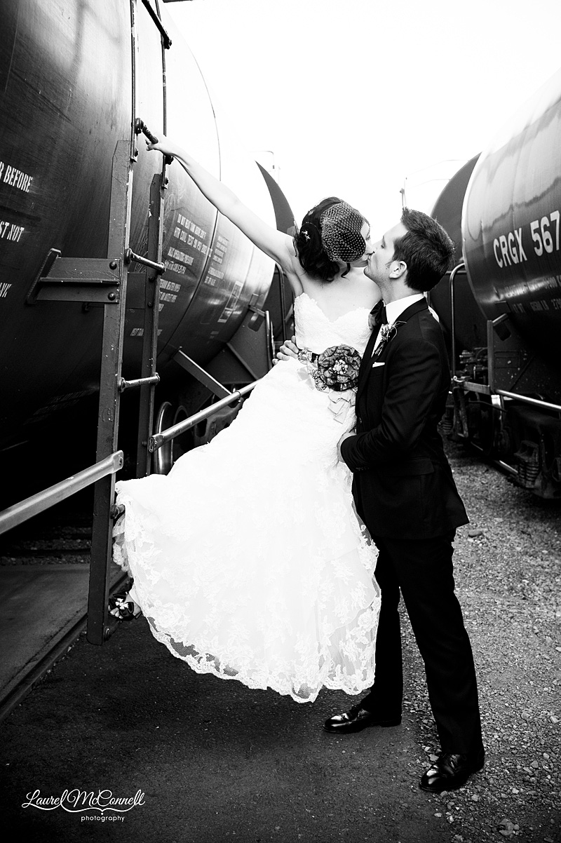 wedding photography in seattle of couple kissing on black trains