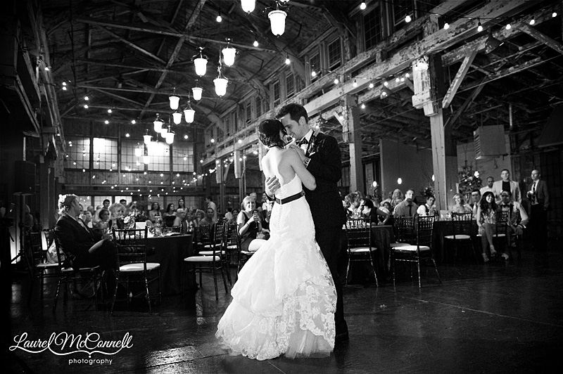 black and white first dance picture during a romantic seattle wedding at sodo park. low light reception with bistro lights