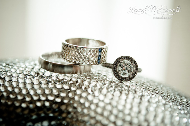 sparkly photograph of a wedding band with sapphires and engagement ring