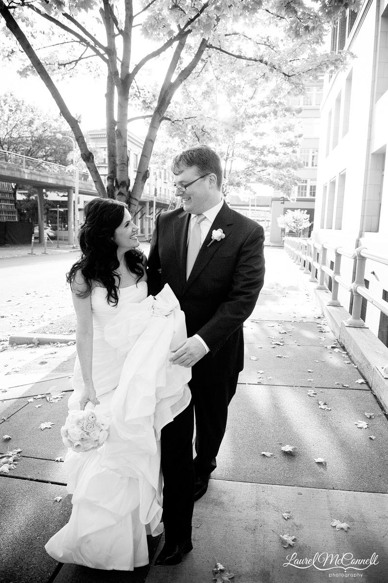 candid wedding photography in black and white of a bride and groom walking
