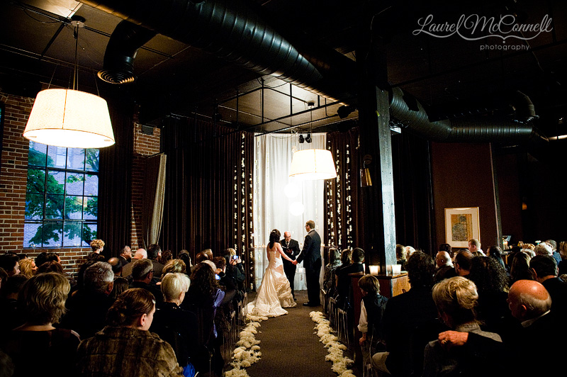 a wedding ceremony in the evening at palace ballroom in seattle