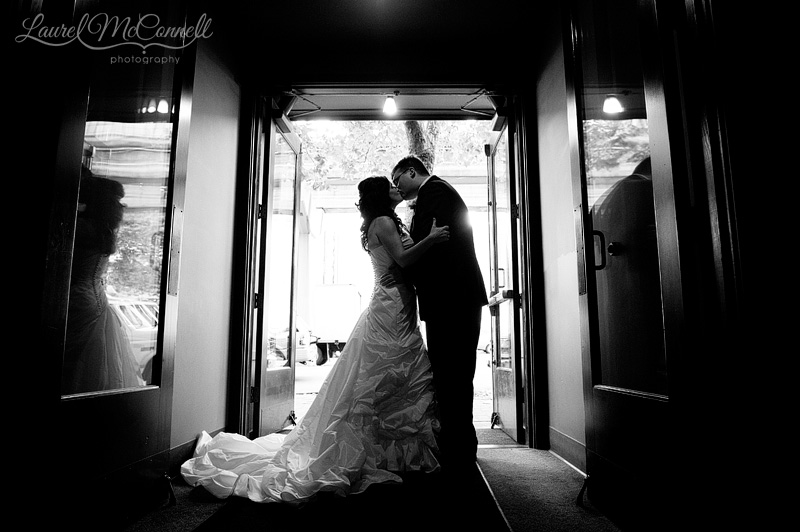 black and white silhouette of a wedding couple at the palace ballroom entrance