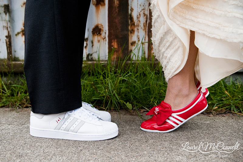 red white and grey wedding shoes by adidas, embroidered with the bride and groom's initials and wedding logo. photographed by seattle wedding photographer laurel mcconnell