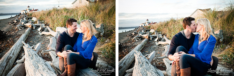 couple sitting among driftwood for beach engagement photos