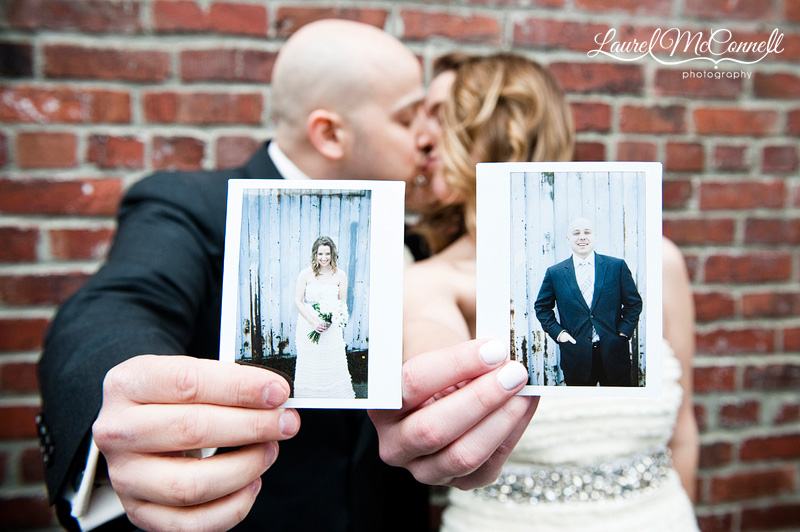 trendy bride and groom portraits using polariods and a brick wall, while kissing of course. photographed by seattle wedding photographer laurel mcconnell