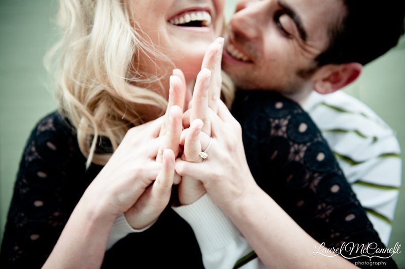a couple laughing and holding hands during engagement photography session in seattle