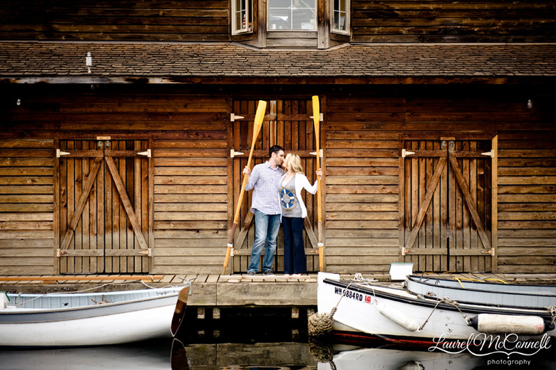 couple kissing with paddles at the vintage boat house
